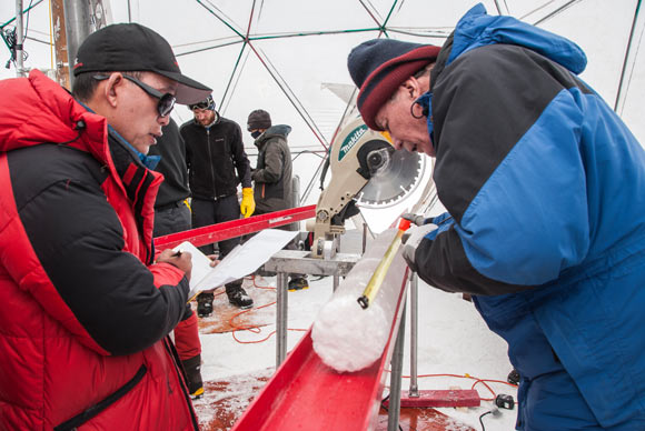 Yao Tandong, left, and Lonnie Thompson, right, process an ice core drilled from the Guliya ice cap in the Tibetan Plateau in 2015. Image credit: Lonnie Thompson.